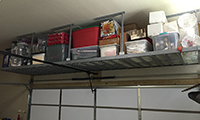 64 sq/ft of additional storage space can be found above your double car garage door.