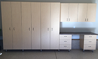 Maple cabinets, stainless steel legs and custom handles provided by the owner
